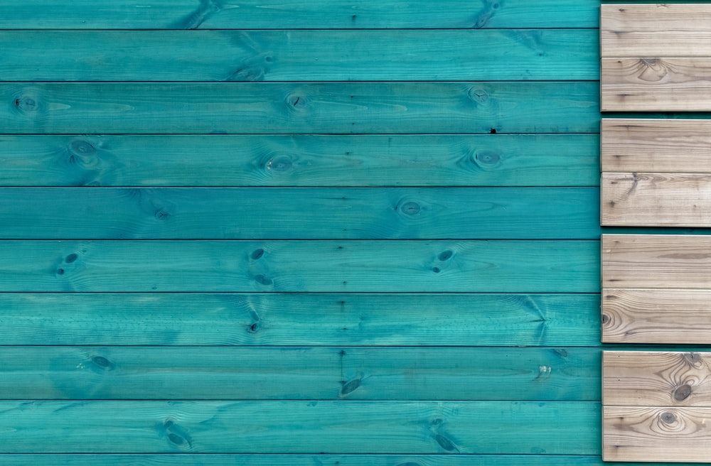 teal and gray wooden panel