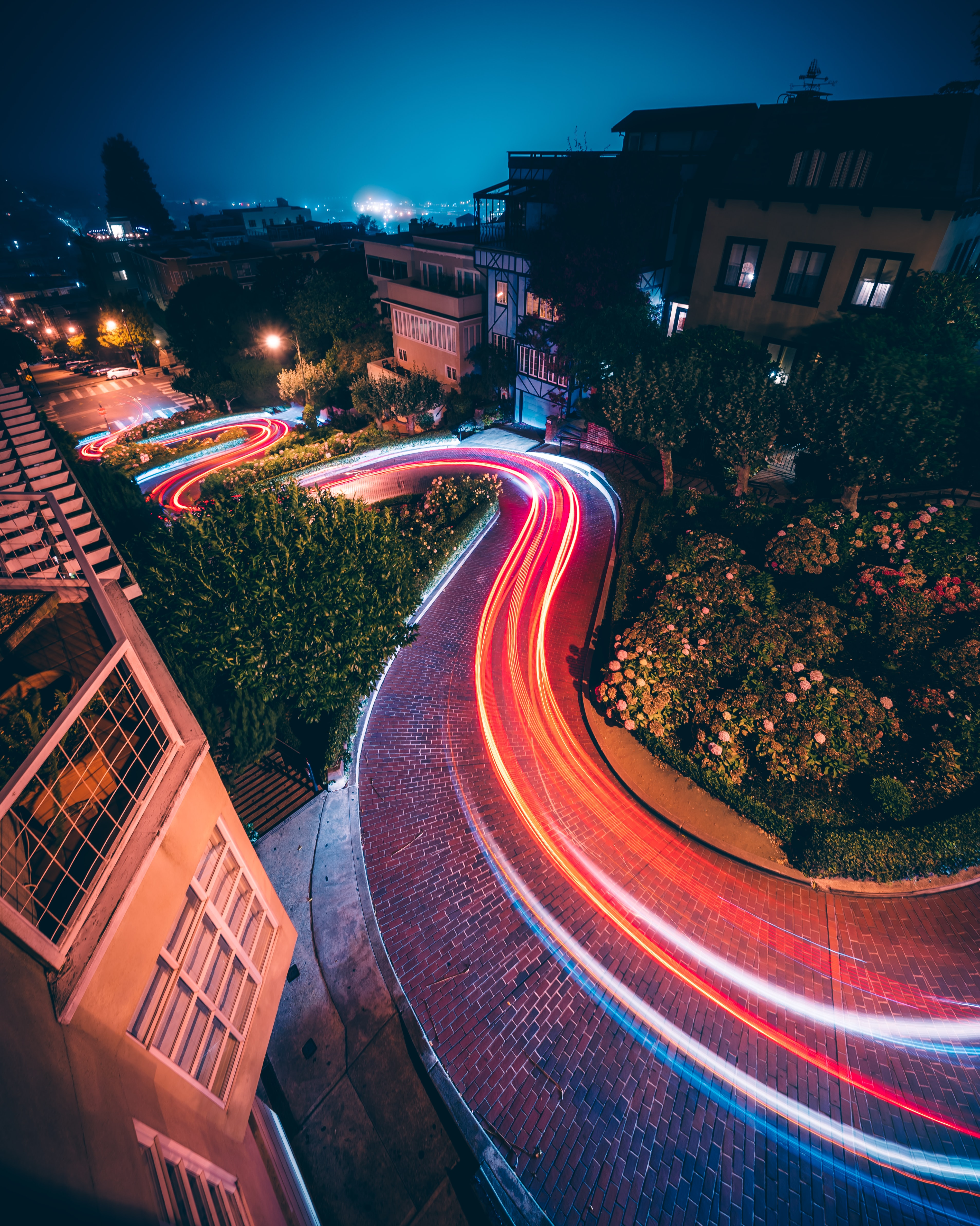 timelapse photography of vehicles near buildings