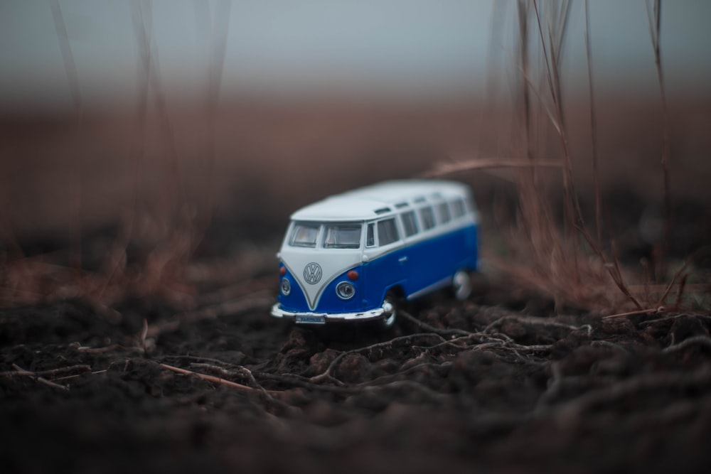 white and blue classic Volkswagen T1 die-cast miniature on ground