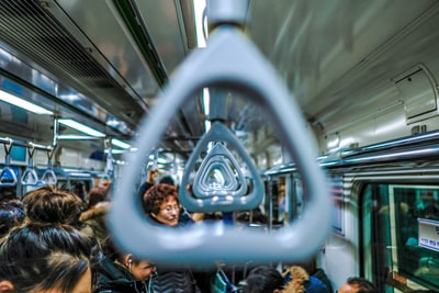 people riding train south korea zoom background