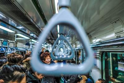 people riding train south korea teams background
