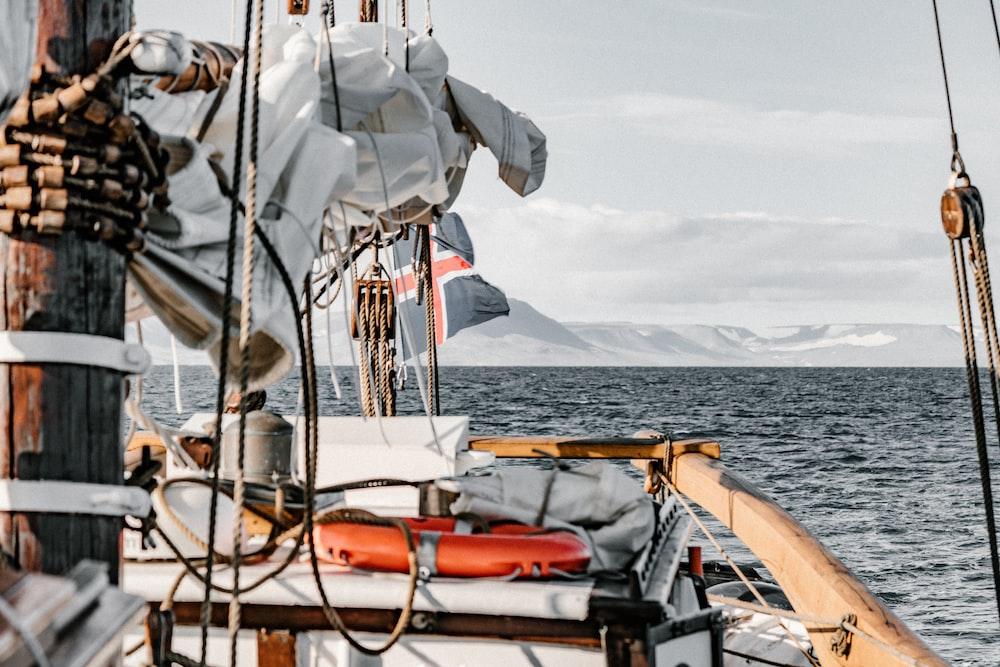 brown boat on ocean during daytime