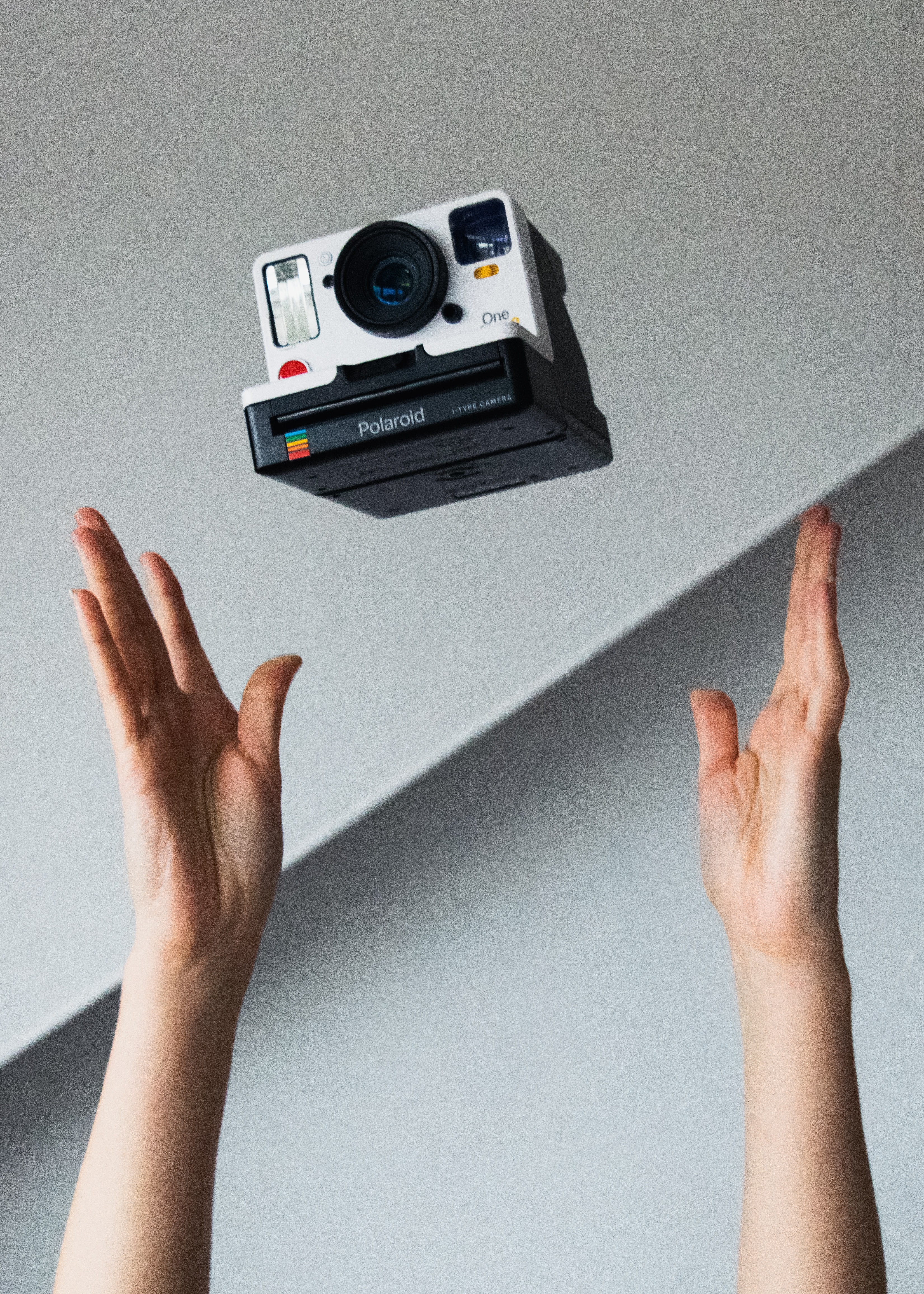 white and black action camera