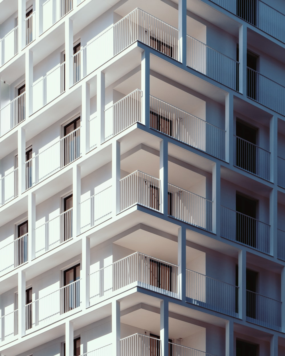 low-angle photography of white concrete high-rise building during daytime