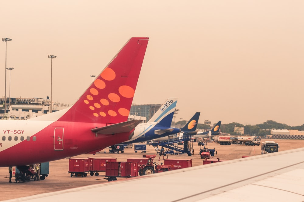four airliners parked beside airport