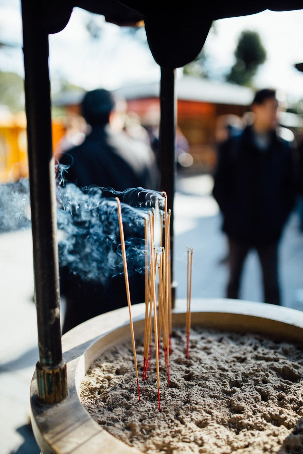 shallow focus photo of incense