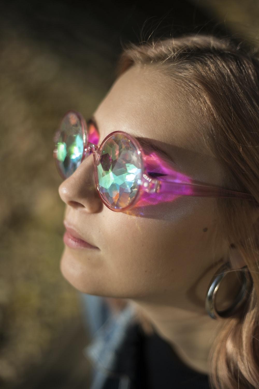 woman wearing pink framed eyeglasses