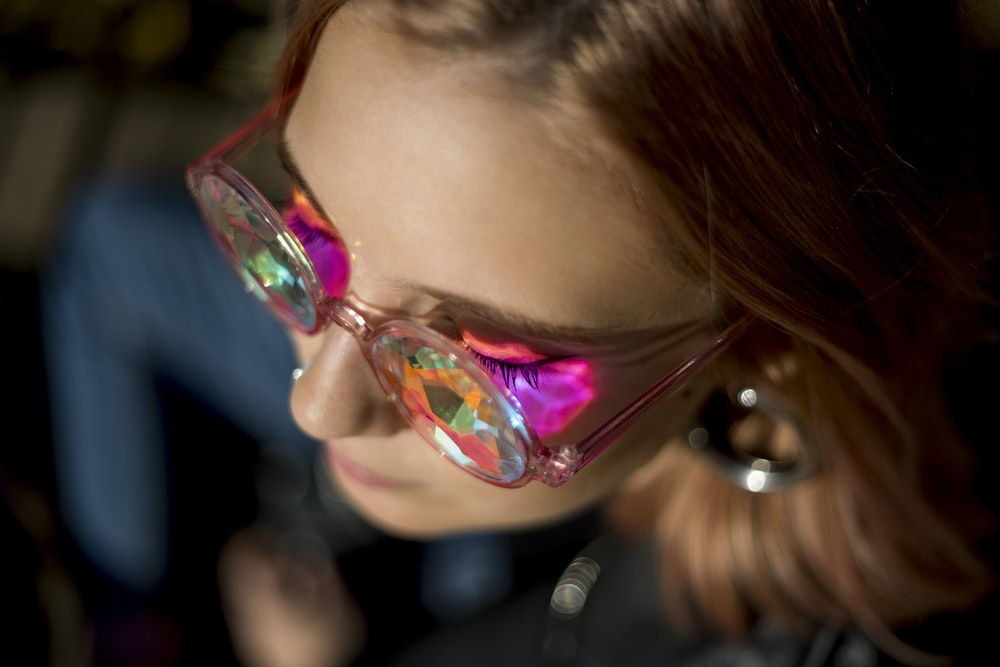 woman wearing pink framed glasses