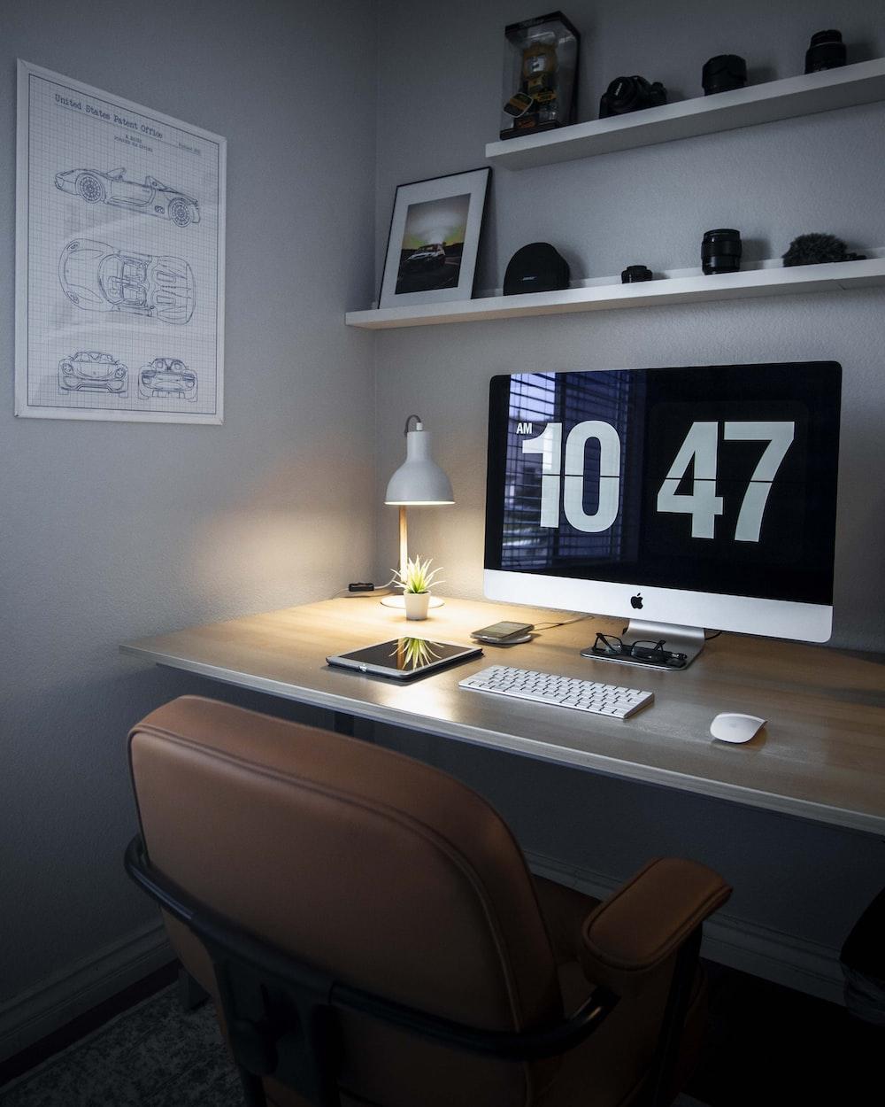 silver iMac displaying 10 47