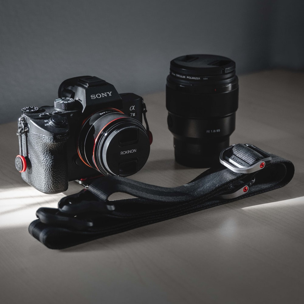 black Sony DSLR camera with lens