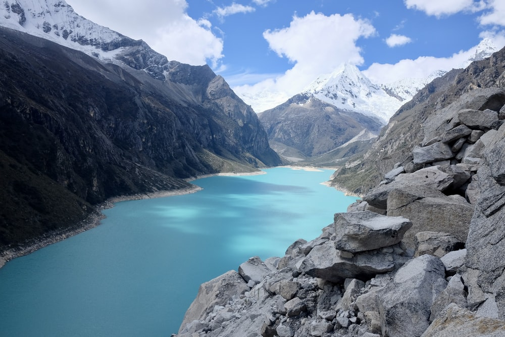 blue lake between rock formations