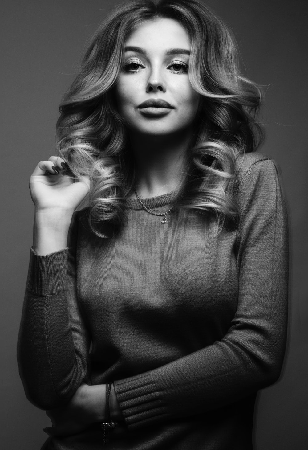 grayscale photo of woman in black sweater
