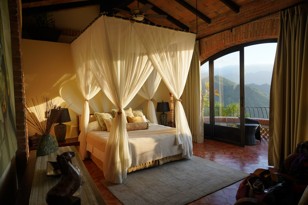 white canopy bed in room