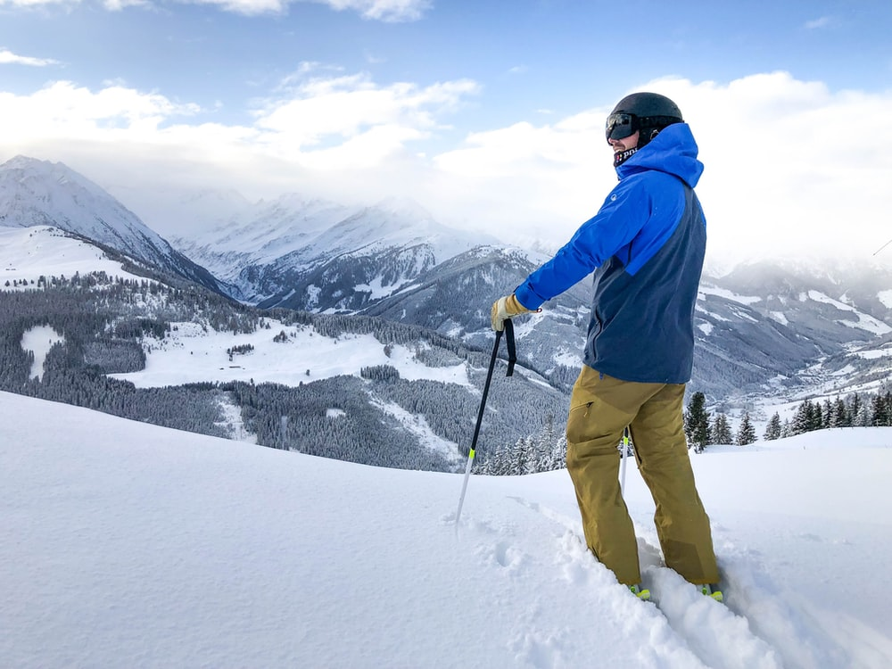 man in skier on snow covered field at daytimee