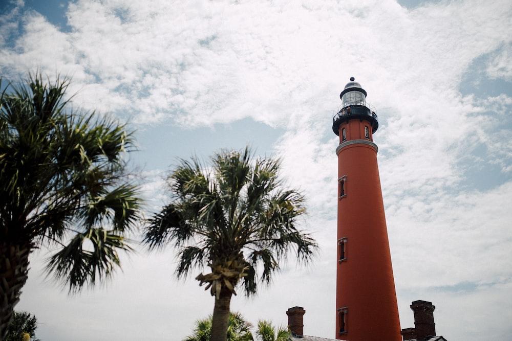red lighthouse under blue sky