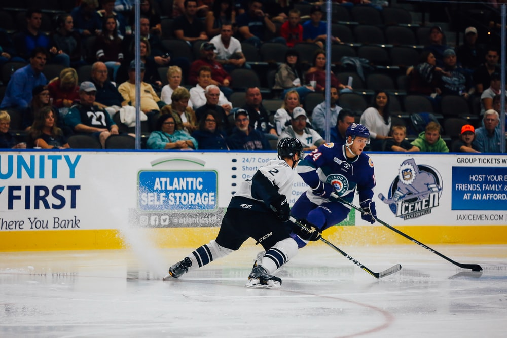 two ice hockey player on field