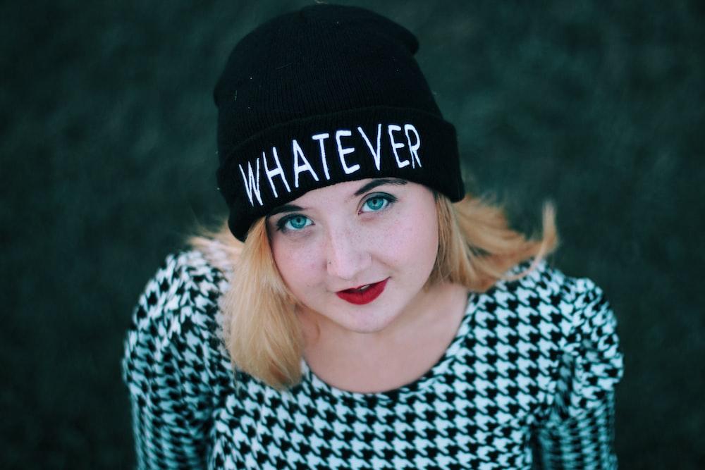 smiling woman wearing black knit cap