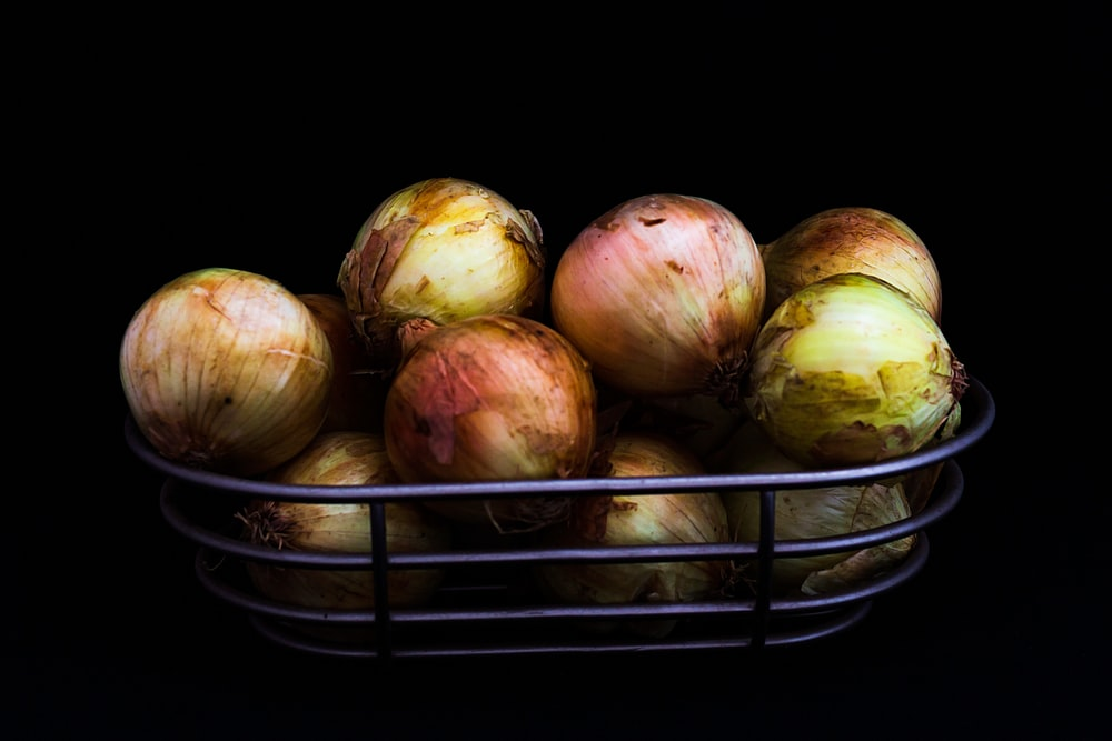 red onions on black basket