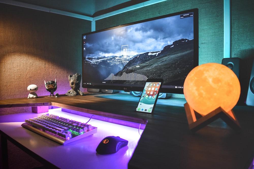 turned-on black flat screen monitor