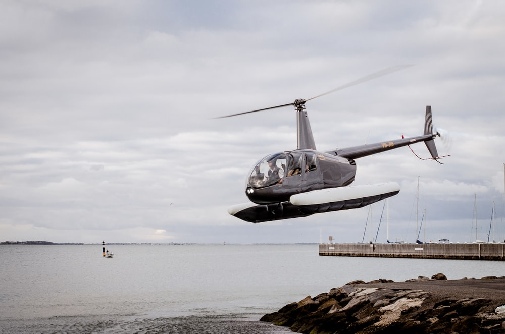 hray helicopter on air during cloudy sky