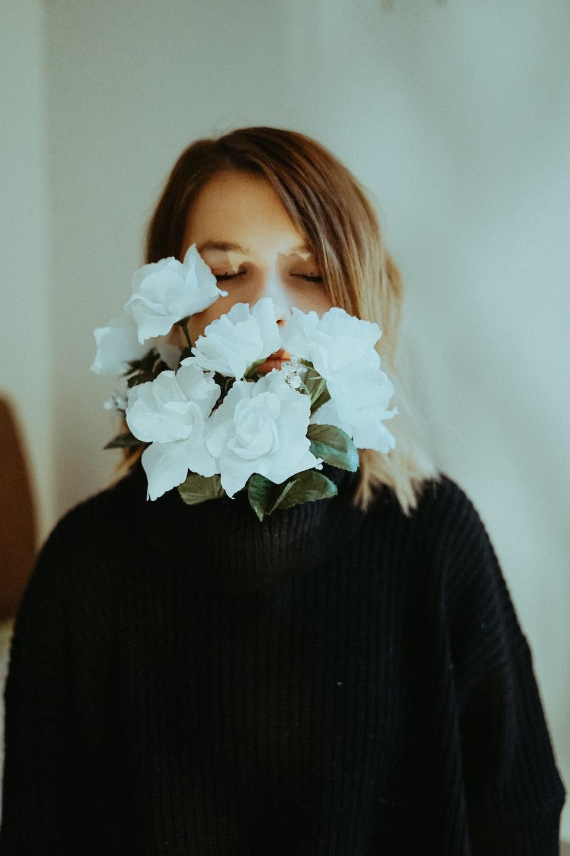 woman biting flowers