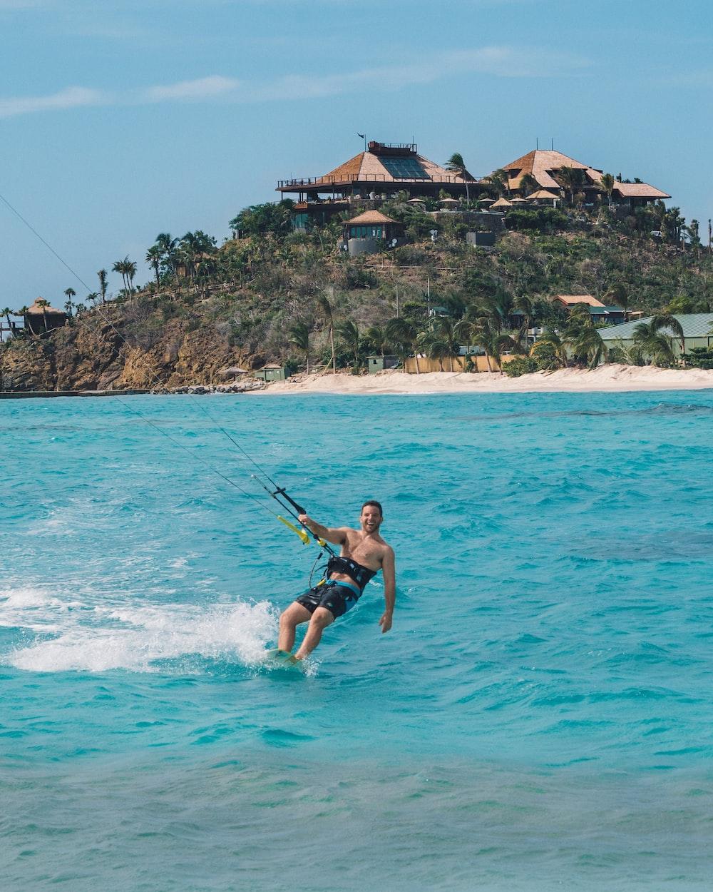 man playing windsurfing board