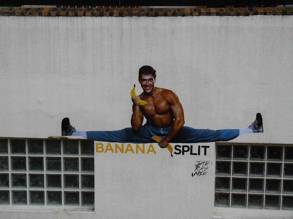man holding banana while split wall painting