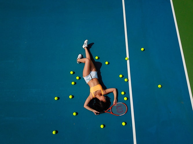 tired sports women lying on the court