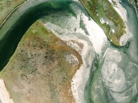 aerial photography of river surrounded by cliff