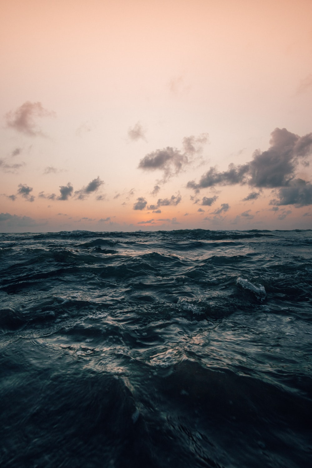 sea under cloudy sky in nature photography