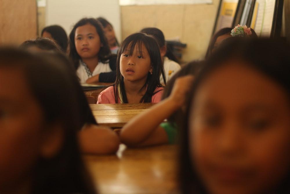 children sitting near table inside room