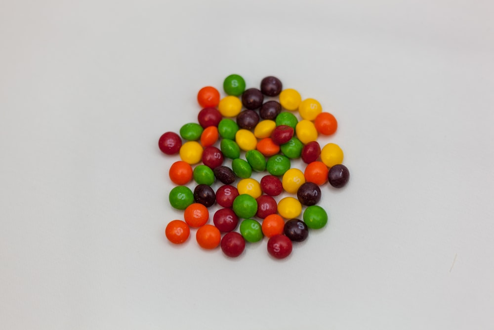 assorted-color chocolates on white surface
