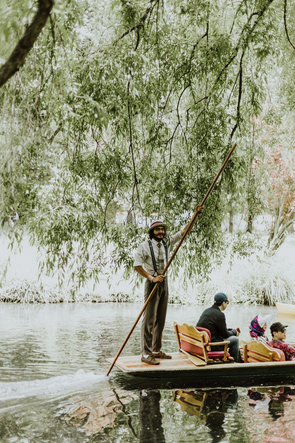 people riding on paddle boat during daytime