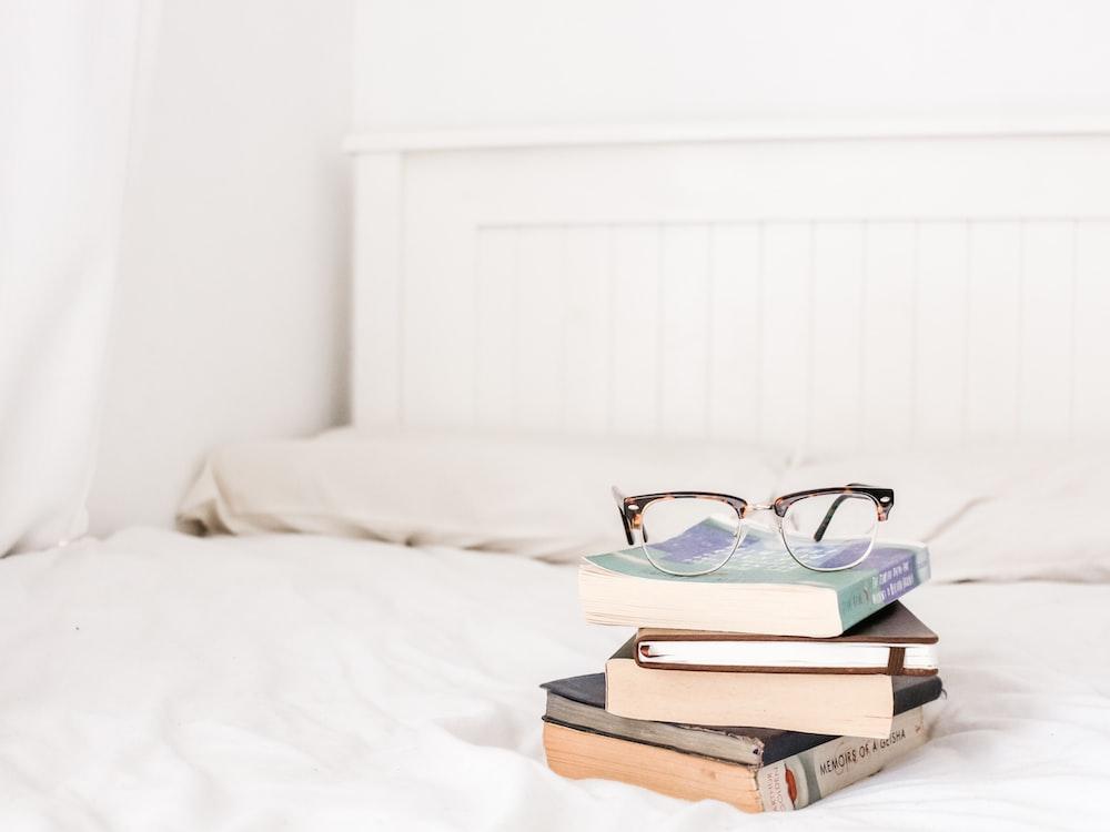 eyeglasses on pile of books