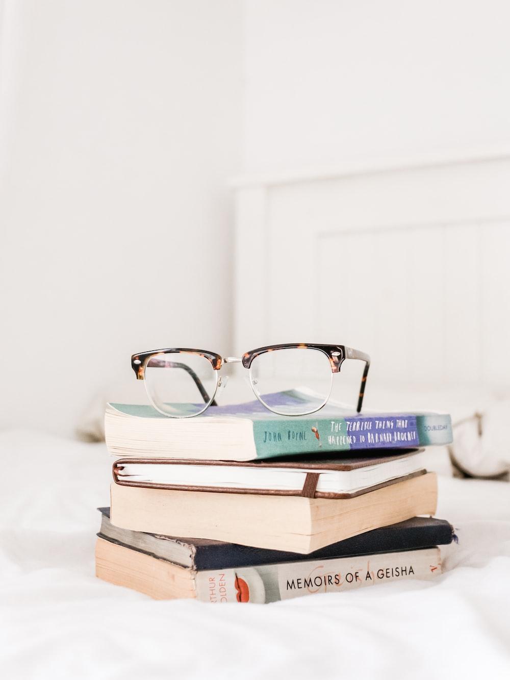 eyeglasses on top of filed books