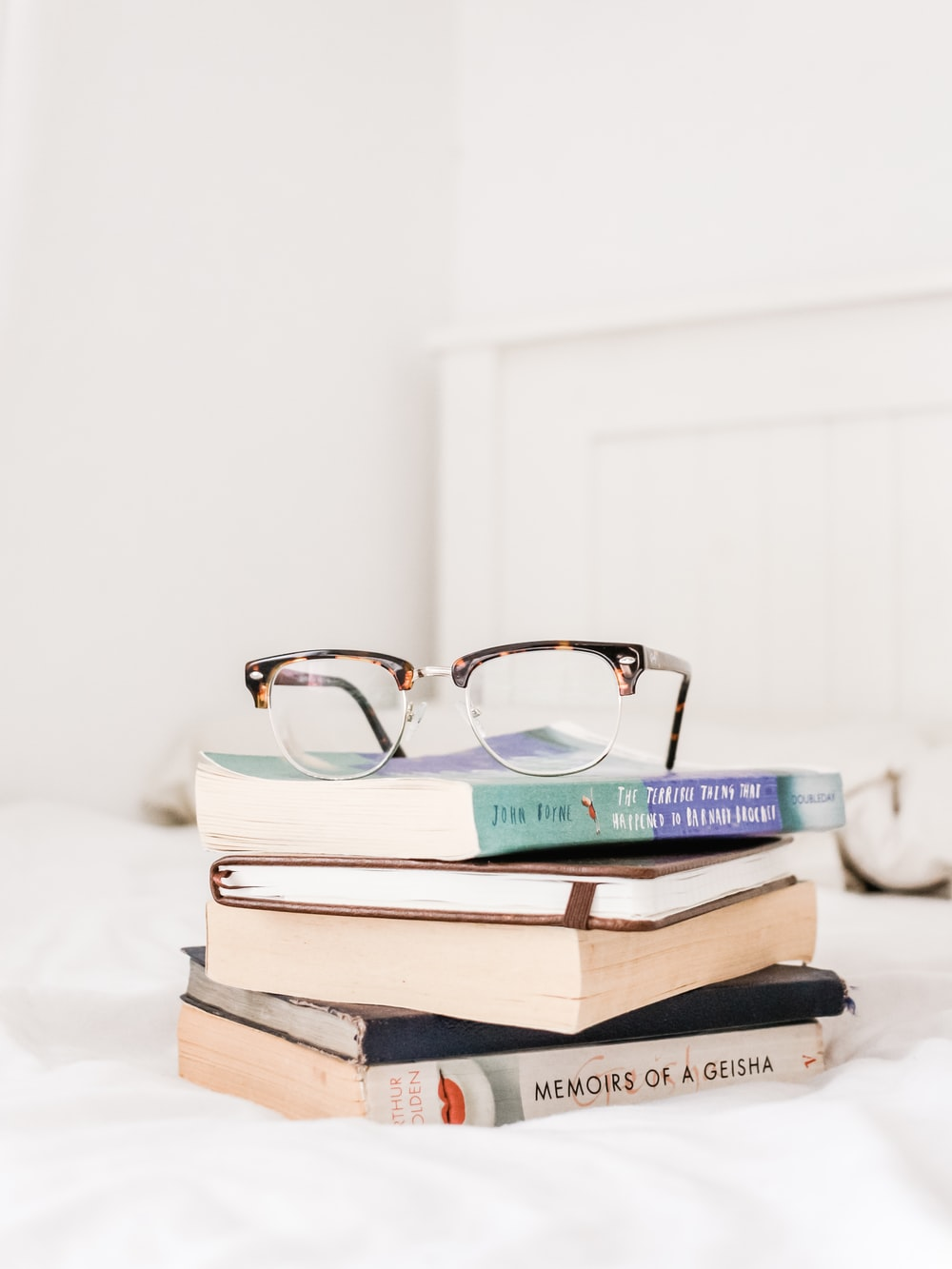 eyeglasses on top of filed books