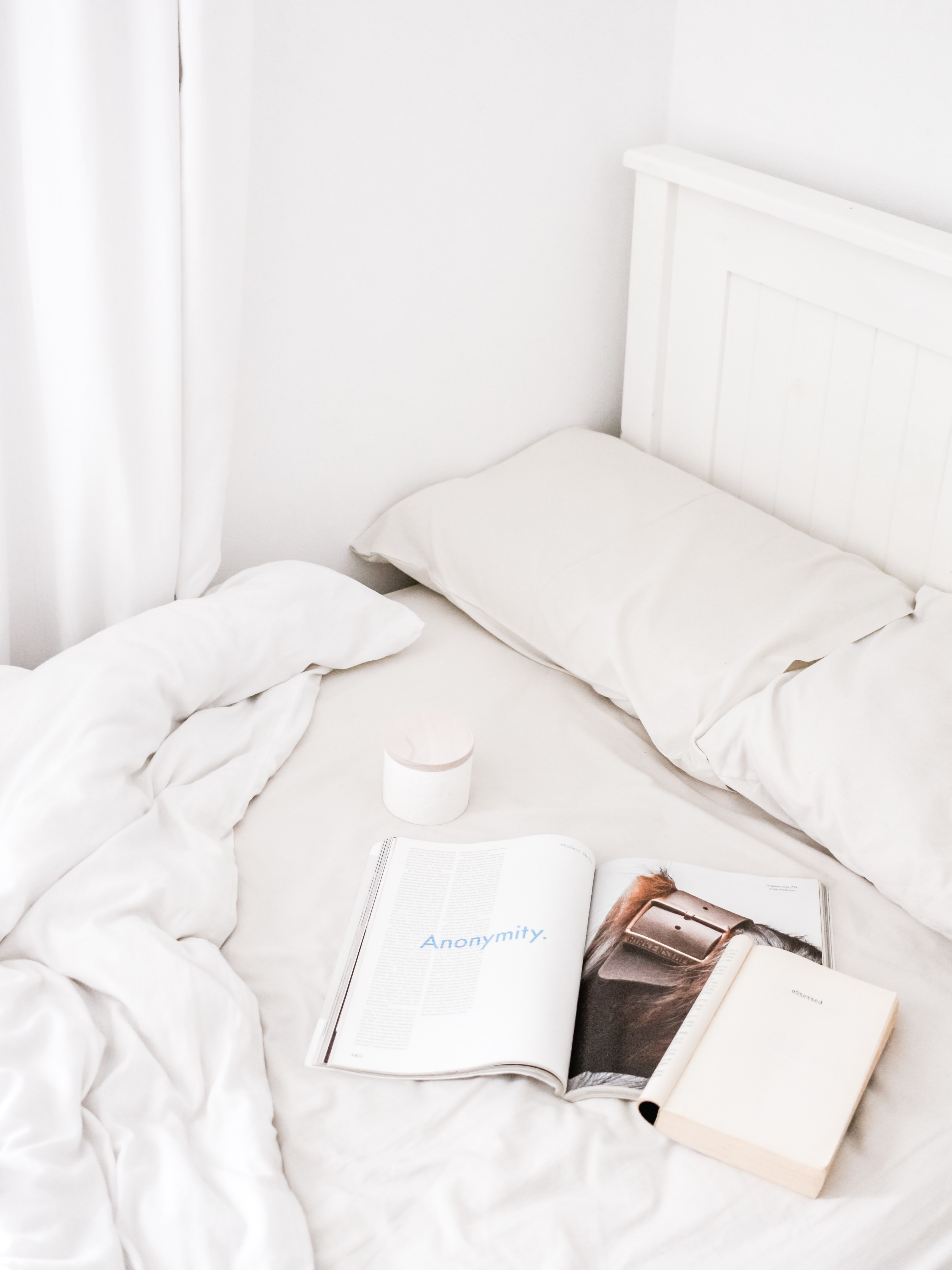 white book on bed