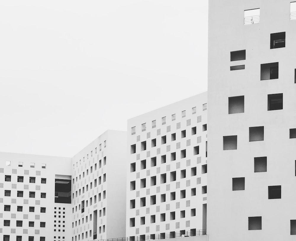 white buildings under white sky