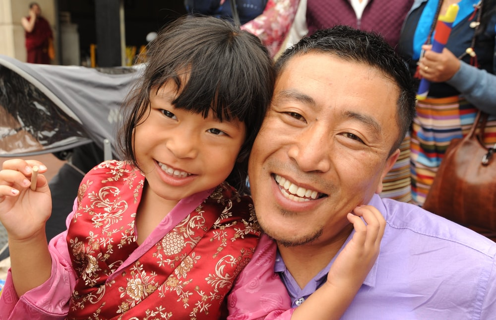 smiling man beside girl