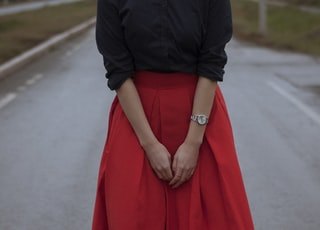 woman wearing black dress shirt and red long skirt