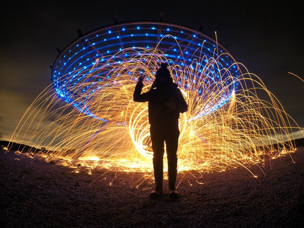 silhouette of person with fireworks backbround