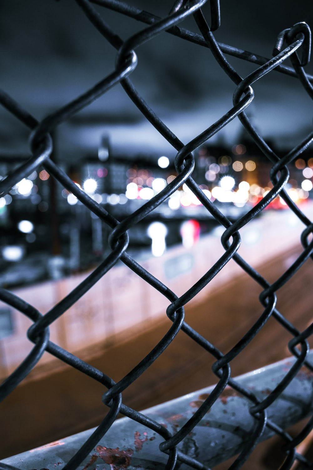 lighted buildings outside of chainlink fence