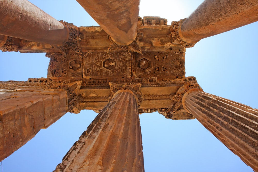 low angle photography of brown pillars