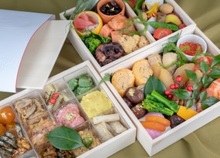 chocolates and fruits on three boxes