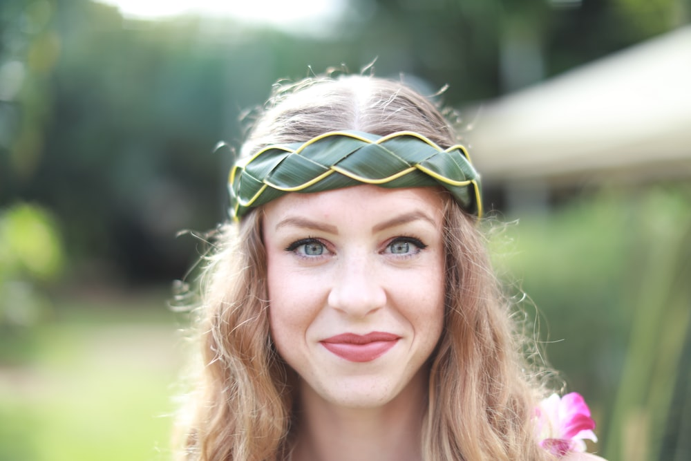 woman wearing green woven head band