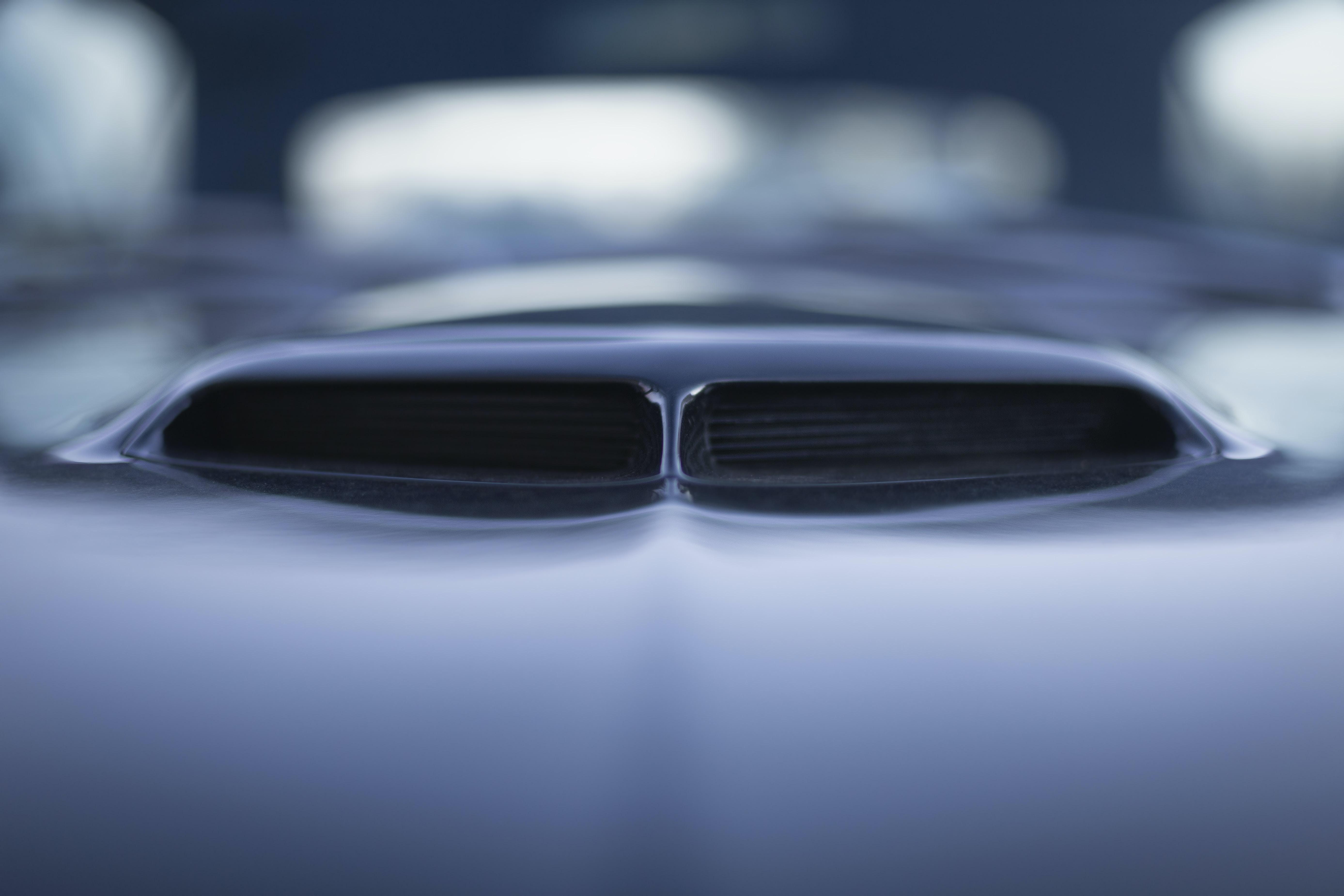 closeup photo of vehicle hood with intake scoop