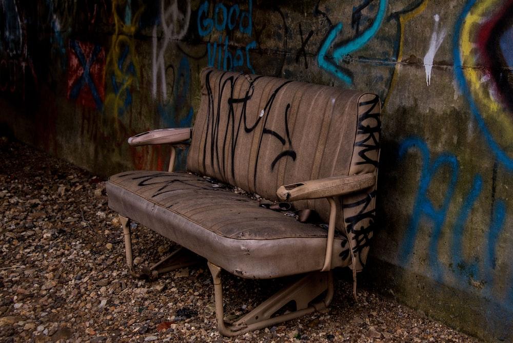 empty brown leather sofa near wall