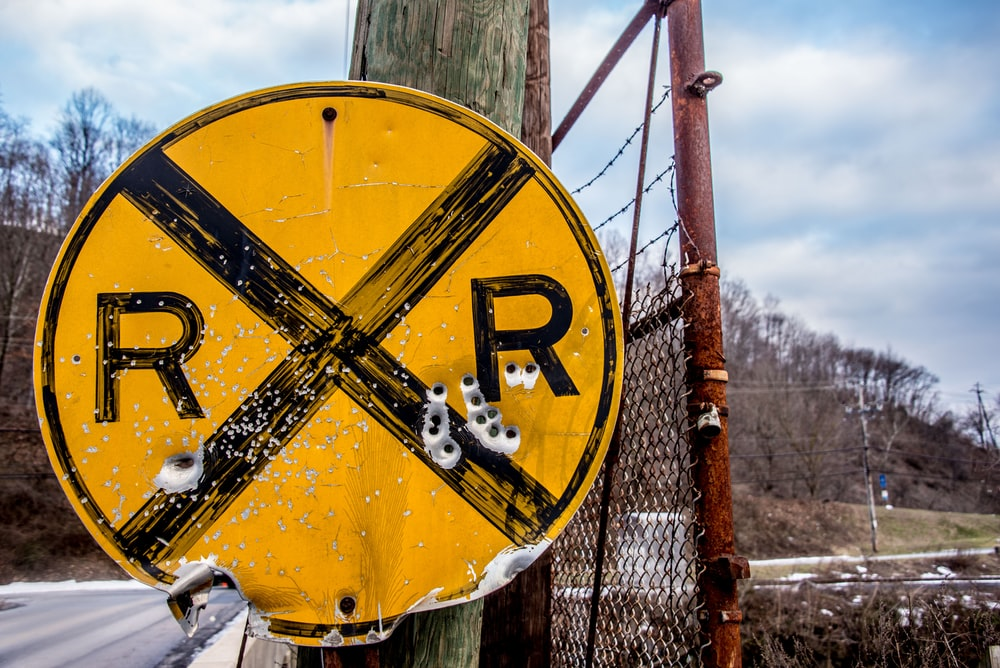 RXR road signage with bullet holes
