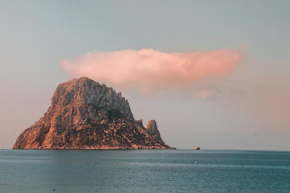 island under white clouds