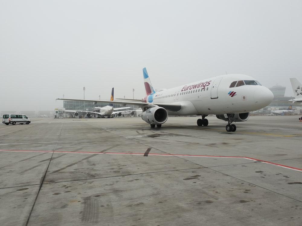 white plane on air port